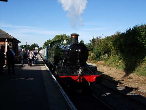 Steam train pulling in to Ongar Station