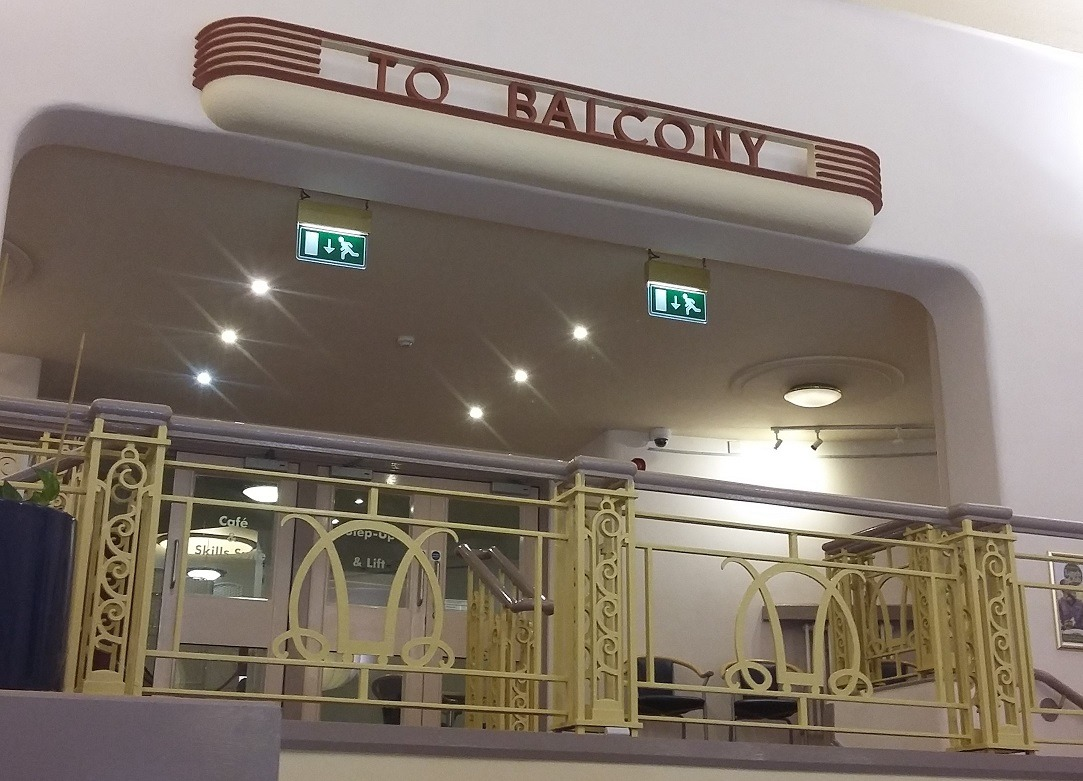 Sign reading 'To Balcony'